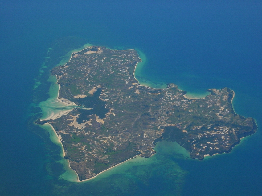 Aerial view of offshore island with fringing reef