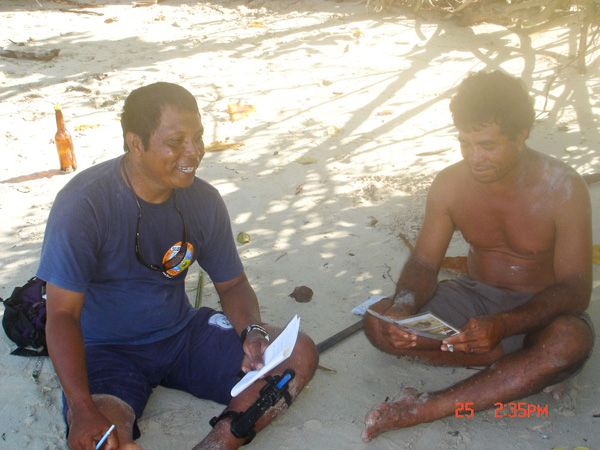 Asril Djunaidi explaining to fishermen that it is important not to catch turtles because they are threatened.