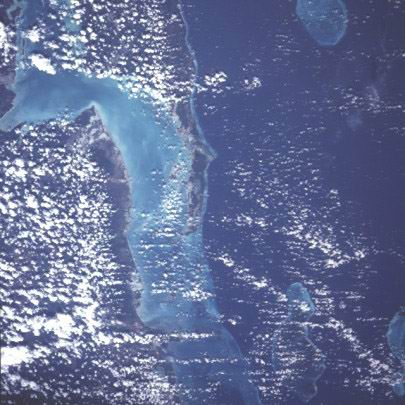 A view of the coast of Belize from Chetumal Bay to the Turneffe Islands.  This slightly oblique south-facing view has been reoriented 180 degrees so that north is toward approximately 10:00.