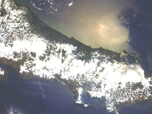 A view of the southern half of Costa Rica under low light with sunglint.  North is at approximately 10:00.