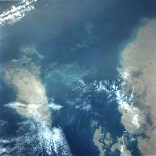 A north-looking view of Bahrain (on the left), Fasht Adhm (center) and the northwest coast of Qatar.