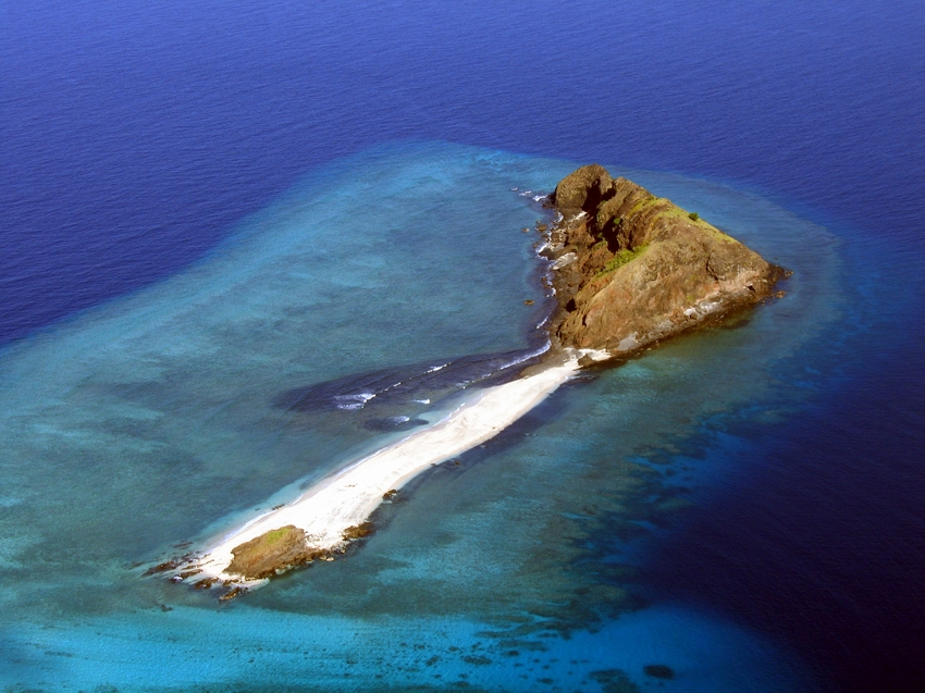 Aerial view of offshore island with its reef flat