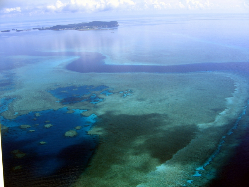 Aerial view of extensive coral reef area near the main island