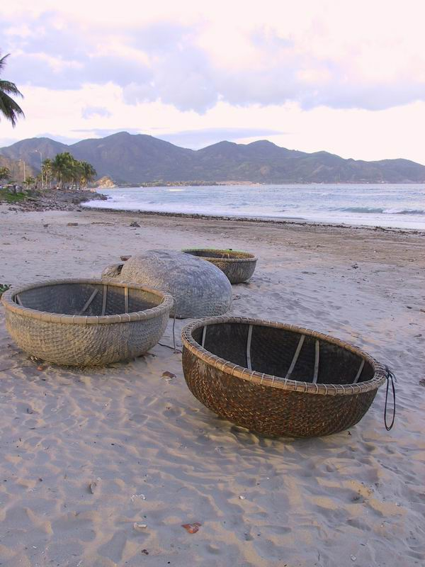 Basket boats on the beach. These are used as dinghies extensively in Vientnam and are made from bamboo.