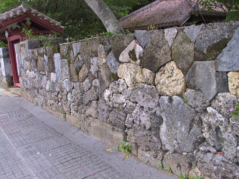 A wall surrounding a local temple made from cut coral colonies
