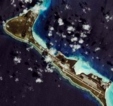The image shows Diego Garcia, a 10-square-mile British Island.  The image shows that the island was spared from tsunami damage on Dec. 26. News reports say that due to favorable ocean topography, including a deep underwater trench